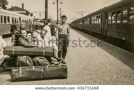 LODZ, POLAND, CIRCA 1960: Vintage photo of people with big luggage waiting for a train on platform - stock photo