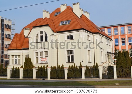 LODZ,POLAND, 28 FEBRUARY 2016; Art Nouveau Villa in Lodz from the early twentieth century, against the backdrop of modern architecture. The diversity of architecture in Lodz,