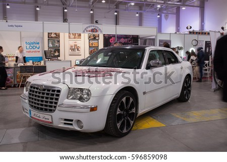 Lodz, Poland, January 29, 2017: Wedding Fair, white  Chrysler 300c with flowers and Wedding decorations