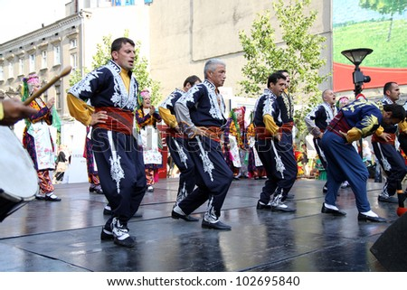 LODZ, POLAND - JULY 28: A folklore dancing group from Turkey, performs during the International Folk Festivals in Lodz, on June 28, 2011 in Lodz, Poland.