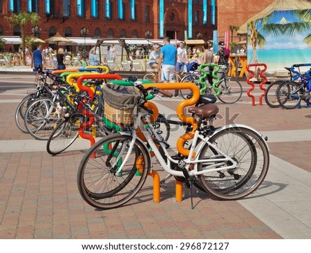 LODZ, POLAND - 12 JULY 2015 - Bicycle stand, the Manufacture in Lodz
