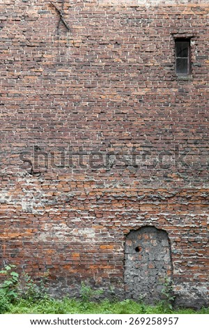 LODZ,POLAND-JUNE 12: old wall on the side of the road ,Poland's second largest city, is the largest industrial city ,  also the center of the textile industry on June 12 ,2010 in Lodz , Poland.