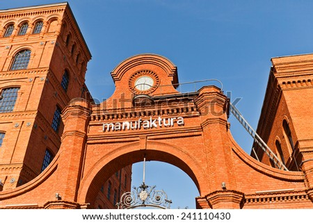 LODZ, POLAND - OCTOBER 19, 2014: Entrance to Manufacture centre (former factory main gate, circa 1880) in Lodz, Poland. Manufaktura is an arts centre, shopping mall, and leisure complex