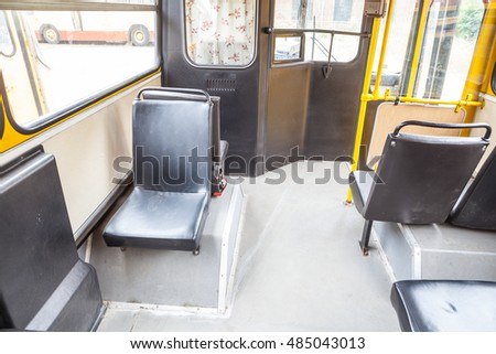 Lodz, Poland, September 18, 2016 inside an old bus, a view of the door and seats