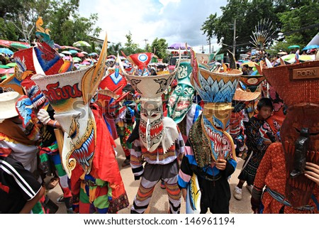 LOEI PROVINCE,THAILAND-JUNE 11:Unidentified men wear ghost costumes at Ghost Festival (Phi Ta Khon - a masked procession celebrated by Buddhist) at Dan Sai district in Loei Province on June 11, 2013.