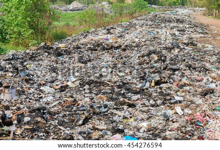 LOEI.THAILAND.APRIL.8.2015: Municipal landfill for household waste.Pile of domestic garbage in landfill in Thailand. - stock photo