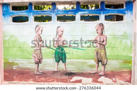 Loei , Thailand - APRIL 17, 2015. Street art on an old brick wall at Chumchonsrisaard school in Loei province Thailand, The wall painted by students in this school, Loei, Thailand.