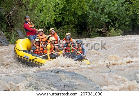 LOEI,THAILAND JULY 27  : Unidentified asian people in action at rafting adventure 2014 on San river on July,27,2014 in Loei Province,Thailand.