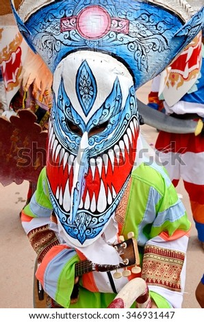 LOEI, THAILAND - JUNE 23, 2014 : Phi Ta Khon Festival ( Traditional ghost mask festival ) Young people dress in spirit and wear a mask, sing and dance .