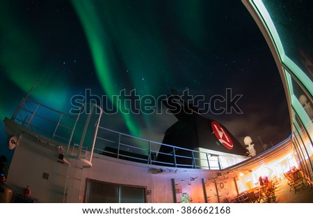 LOFOTEN ISLANDS, NORWAY - CIRCA FEBRUARY 2016: Northern lighs view from the deck of famous Hurtigruten coastal streamer