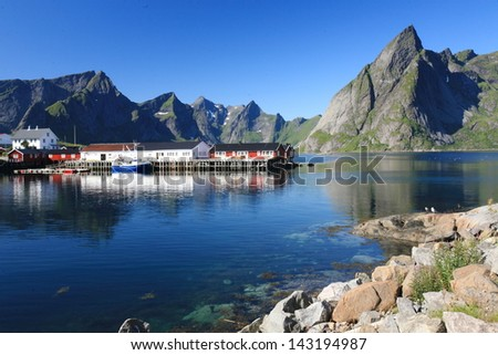 Lofoten islands unesco heritage small fishing villages with wooden huts ferry fjord Lofoten Islands tourism Lofoten Islands norway eco-friendly North Sea Arctic Circle cod fishing