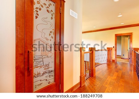Loft balcony with wood and iron railings. View of designed glass door - stock photo