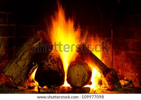 log burning on open fire - stock photo