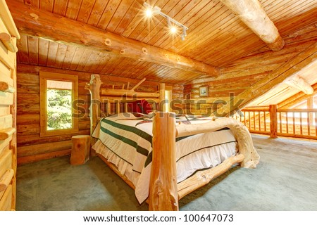 Log Cabin Bedroom Under Wood Large Ceiling With Queen Size Bed.