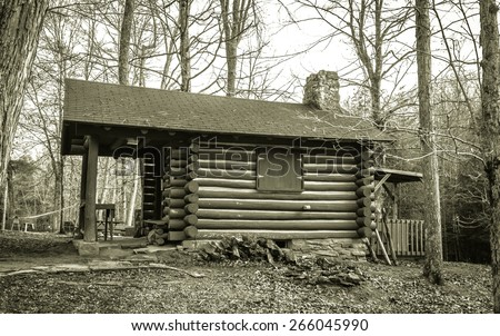Log Cabin Classroom. This quaint log cabin the woods of Southeastern Ohio serves as the Naturalist Cabin classroom in Hocking Hills State Park in Logan, Ohio. - stock photo
