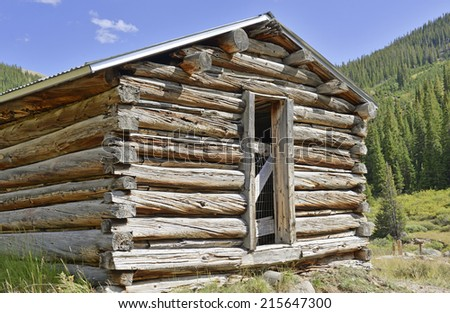 Log cabin in mining town, western USA - stock photo