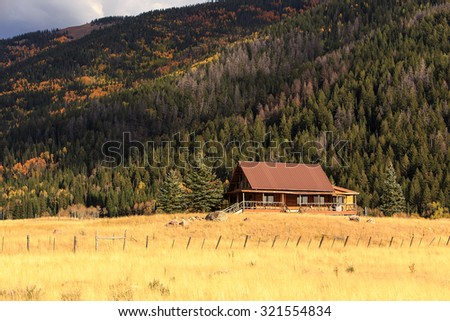 Log cabin in the Rocky Mountains, Utah, USA. - stock photo
