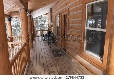 Log cabin porch in the snow