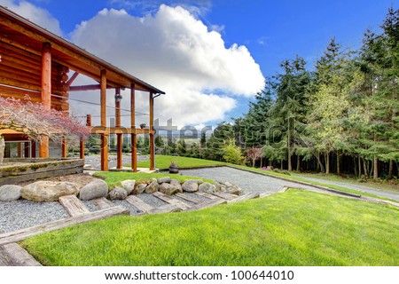 Log cabin with porch on the hill with forest view. - stock photo