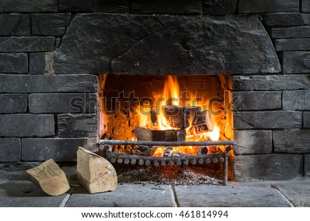 Log fire in open fireplace