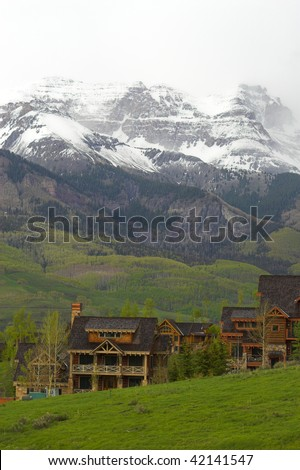 Log houses built high up in the mountains - stock photo