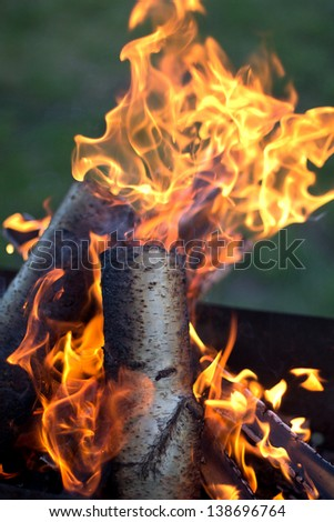 Log on fire with flames - stock photo