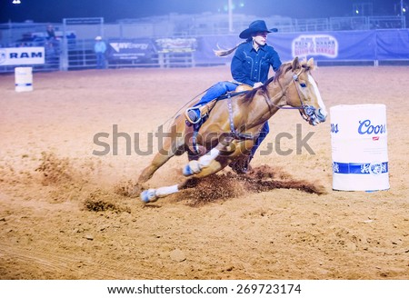 LOGANDALE , NEVADA - APRIL 10 : Cowgirl Participating in a Barrel racing competition in the Clark County Fair and Rodeo a Professional Rodeo held in Logandale Nevada , USA on April 10 2015 - stock photo