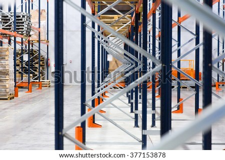 logistic, storage, shipment, industry and manufacturing concept - warehouse shelves or constructions with cargo - stock photo