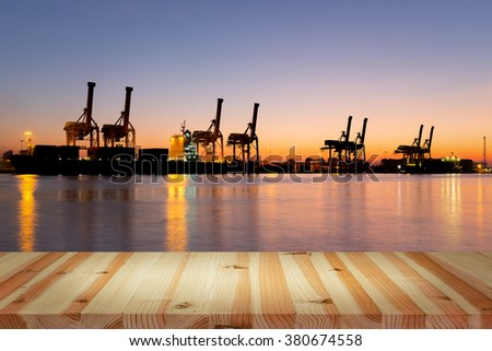 Logistics and transportation of crane and cargo freight ship and cargo container for logistics and transportation background.   - stock photo