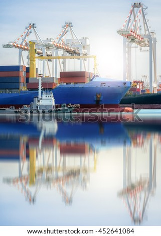 Logistics and transportation of International Container Cargo ship in a harbor with water reflections, Freight Transportation, Shipping, Nautical Vessel - stock photo