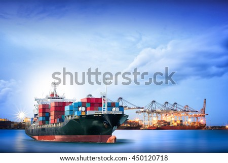 Logistics and transportation of International Container Cargo ship with ports crane bridge in harbor for logistic import export background and transport industry. - stock photo
