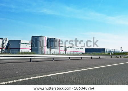logistics center near the highway - stock photo