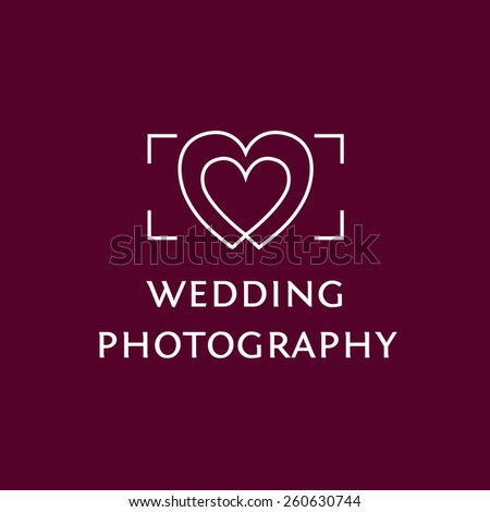Logo with the image of the viewfinder and hearts. Wedding Photography. - stock photo