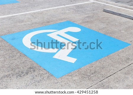 Logos for disabled on parking  - stock photo