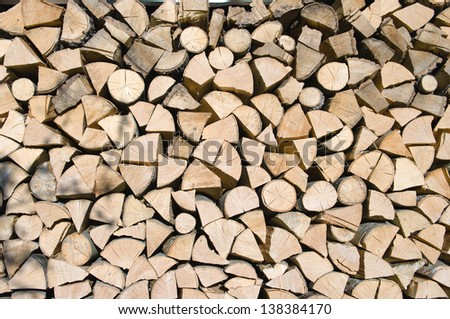 logs of firewood split and stacked (Brajcino) - stock photo