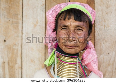 LOIKAW, MYANMAR - JANUARY 23, 2016: A portrait of a woman from the Padaung tribe (Karen) who are famous for wearing large brass coils around their neck.