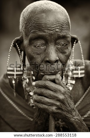 LOITOKTOK - KENYA - JANUARY 6, 2015: Unidentified old Maasai woman with traditional earrings poses for a portrait on January 6, 2015 in Loitoktok, Kenya. - stock photo