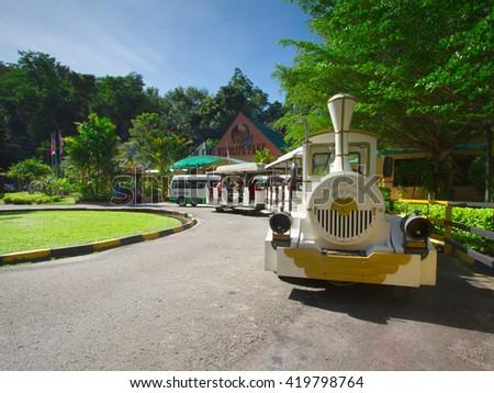 LOK KAWI,SABAH,MALAYSIA-DECEMBER 12,2013:Lok Kawi Wildlife front view with classical train fasilities for tourist. - stock photo