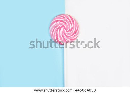 Lollipop on blue and white background