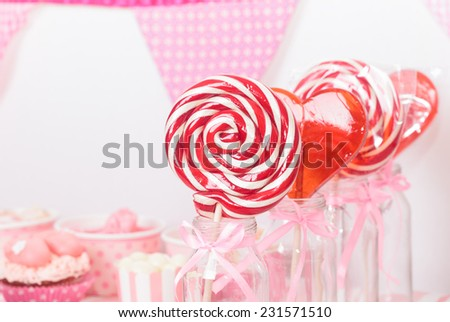 lollipops in dessert table at girls birthday party - stock photo
