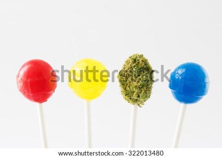 lollipops with marijuana bud - stock photo