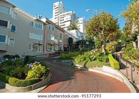 Lombard street in San Francisco with a beautiful blue sky, the crookedest street in the world - stock photo