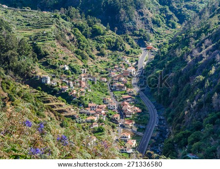 Lombo Do Moleiro village in the valley mountains of the island of Madeira. View from the mountain. Portugal. - stock photo