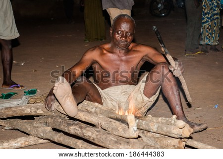 LOME, TOGO - MAR 7, 2012: unidentified Togolese man make fire  for the fire show performance. People in Togo suffer of poverty due to a difficult economical situation
