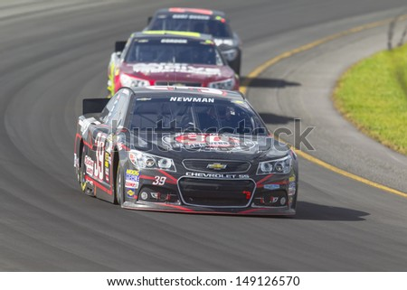 LOMG POND, PA - AUG 04, 2013:  Ryan Newman (39) takes to the track for the GoBowling.com 400 race at the Pocono Raceway in Long Pond, PA on Aug 4, 2013. - stock photo