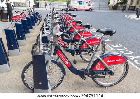 LONDON - APR 6, 2015: Row of rental bikes from Santander Cycles. Santander Cycles is London's self-service, bike-sharing scheme for short journeys. - stock photo