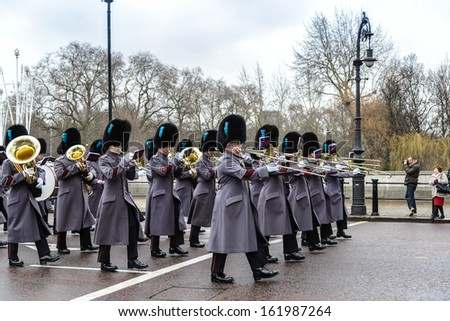 LONDON - APR 15: The changing of the guard ceremony at Buckingham Palace on April 15th, 2013 in London, UK. It is one of England's most popular visitor attractions. - stock photo