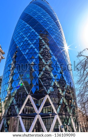 LONDON - APR 3 : The modern Gherkin tower pictured on April 3rd, 2013, in London, UK. Known as the SwissRe Building (completed in 2003), Sky News broadcasts its flagship programme Jeff Randall Live. - stock photo
