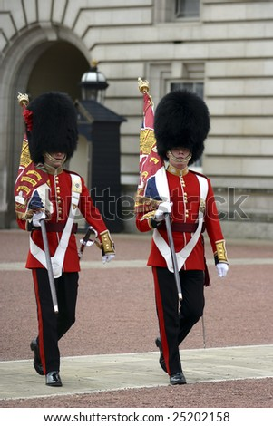 London, April 17, 2004. A couple of members of the England Queens' Guard  are preparing to make the change of the guard in the Buckingham Palace on 17 April 2004. - stock photo