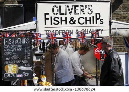 LONDON - APRIL 20: A food stall, fish and chips, famous tourist attractions in Camden Town, on April 20, 2013 in London, UK. The Market attracting about 100,000 visitors each weekend.  - stock photo